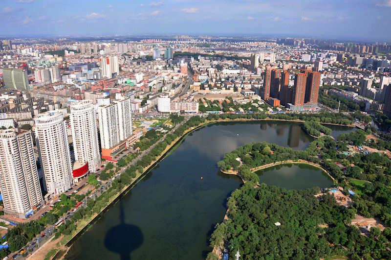 Liaoning, Shenyang, modern housing, lake